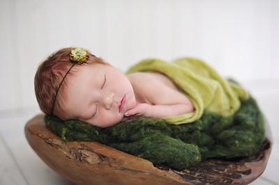 Father Cradling Newborn Baby