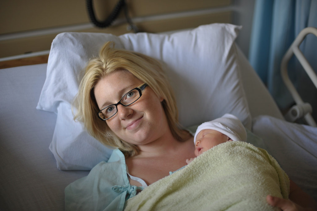 Mother in Hospital Bed With Newborn