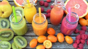 Multicolored fruit smoothies