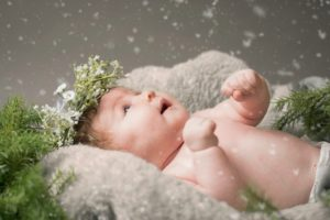baby with snow flakes