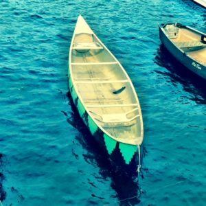 Empty canoe in water